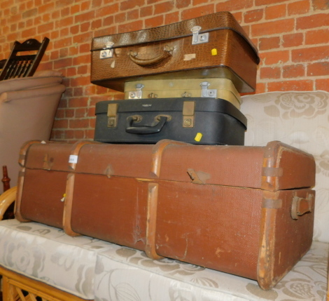 A brown canvas trunk, together with three composite suit cases. (4)