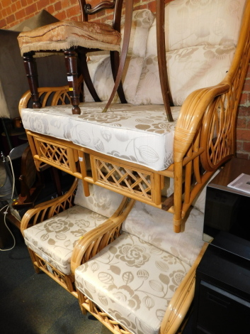 A bamboo three piece conservatory suite, upholstered in gold and cream brocade.