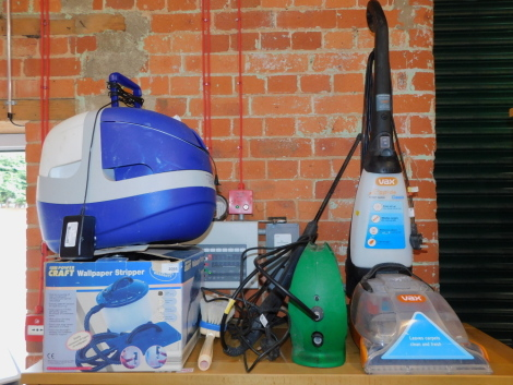 A VAX carpet washer, pressure washer, wallpaper stripper, and a paint pod. (4)