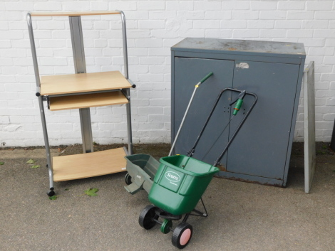 A steel office cupboard, computer station and two seed drills. (4)
