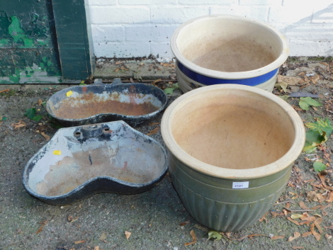 A pair of glazed plants pots (AF), together with a pair of cast iron drinking troughs converted to planters. (4)