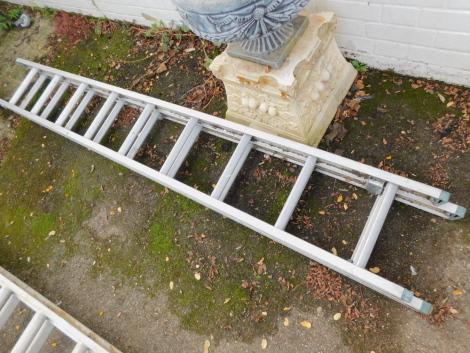 An aluminium extending ladder.