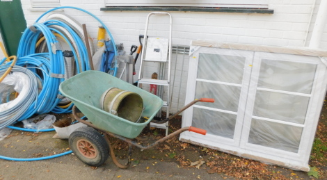 Plastic piping, garden tools, ladder, wheelbarrow, window (new and sealed), etc. (a quantity)