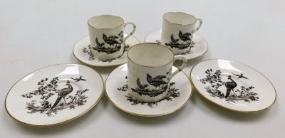 Three Royal Worcester coffee cans and five saucers, each decorated with a blackbird, with black stamp to underside.