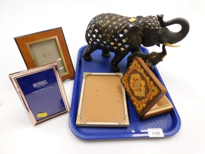 A group of Eastern ornaments, two gem set elephants, wooden trinket box, and a group of photograph frames. (1 tray)