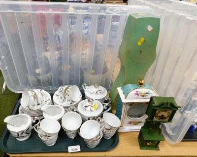 A Japanese part tea service, a novelty miniature wooden long case clock, a Past Times porcelain clock case, etc. (1 tray and 3 items)