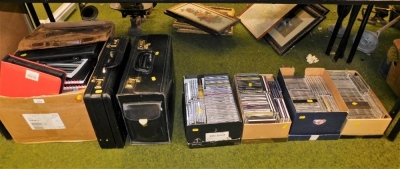 Miscellaneous office wares and CDs, two briefcases, two carry cases, various notepads, etc. (all under 1 table)