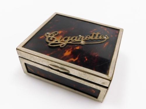 A 1930s faux tortoiseshell and chrome plated cigarette box.