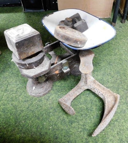 A set of Avery brass weighing scales, various weights and a door latch.