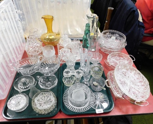 A group of assorted glassware, punch bowls, coloured glass, dressing table sets, two glass lamp shades, etc. (a quantity)
