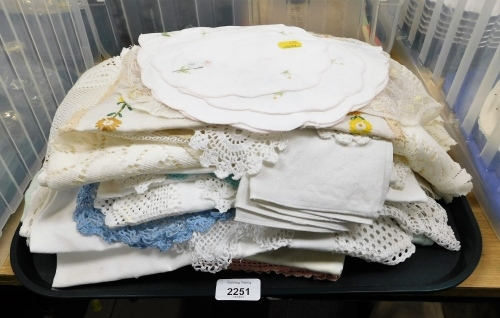 A quantity of linen, tablecloths and doilies.