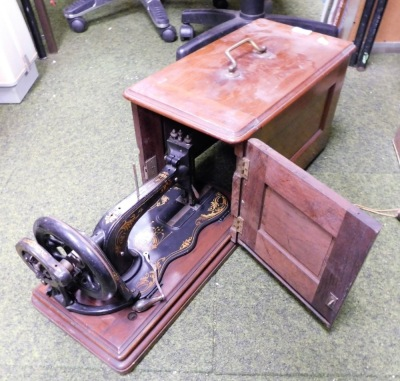 A mahogany cased Singer sewing machine.