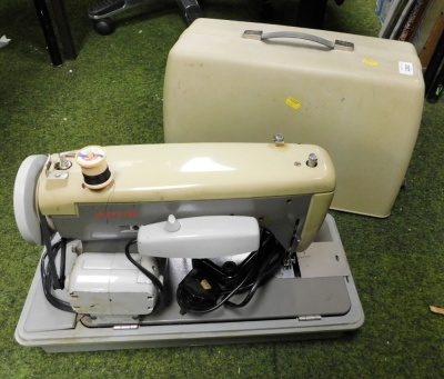 A cased electric sewing machine.
