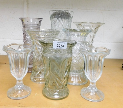 A group of glass vases.