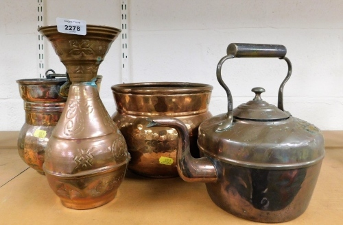 A group of copper wares, to include two copper pots, a teapot and an Eastern style vase. (4)
