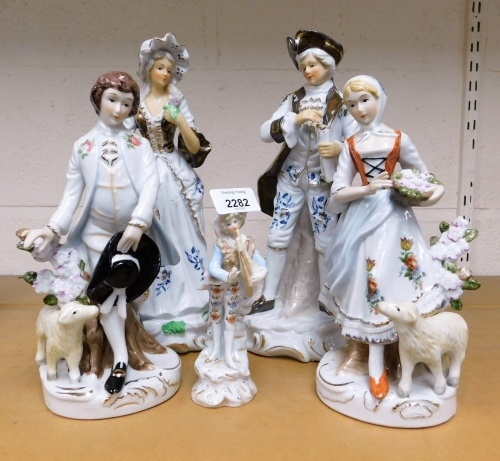 A group of porcelain continental style figures. (5)
