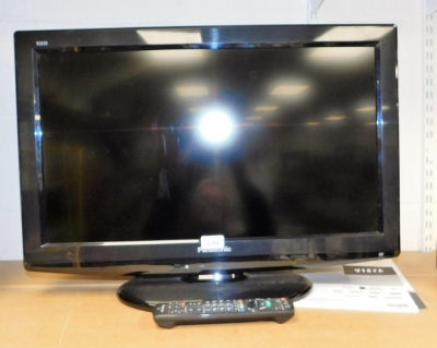 """A Panasonic 25"""" flat screen television with remote control."""