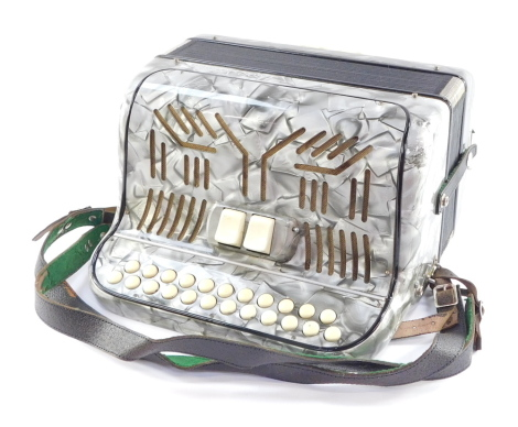 A Paolo Sopranl piano accordion, in silvered overall detailing with ivory coloured buttons, in carry case, 19cm high, 31cm wide, 34cm deep.