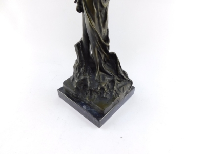 A bronze figure of Andromeda, modeled standing chained to a post, raised on a black marble base, 49cm high. - 3