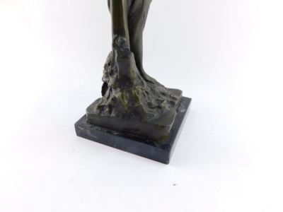 A bronze figure of Andromeda, modeled standing chained to a post, raised on a black marble base, 49cm high. - 4