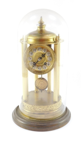 A continental gilt brass dome clock, with a circular dial with silvered Arabic numerals on six column reeded supports with ribbed floral detailing, eight day movement striking a bell, in a glass dome, 38cm high.