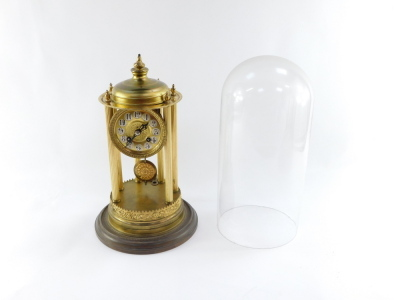 A continental gilt brass dome clock, with a circular dial with silvered Arabic numerals on six column reeded supports with ribbed floral detailing, eight day movement striking a bell, in a glass dome, 38cm high. - 2