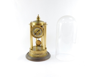 A continental gilt brass dome clock, with a circular dial with silvered Arabic numerals on six column reeded supports with ribbed floral detailing, eight day movement striking a bell, in a glass dome, 38cm high. - 3