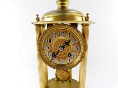A continental gilt brass dome clock, with a circular dial with silvered Arabic numerals on six column reeded supports with ribbed floral detailing, eight day movement striking a bell, in a glass dome, 38cm high. - 5