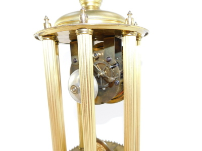 A continental gilt brass dome clock, with a circular dial with silvered Arabic numerals on six column reeded supports with ribbed floral detailing, eight day movement striking a bell, in a glass dome, 38cm high. - 7