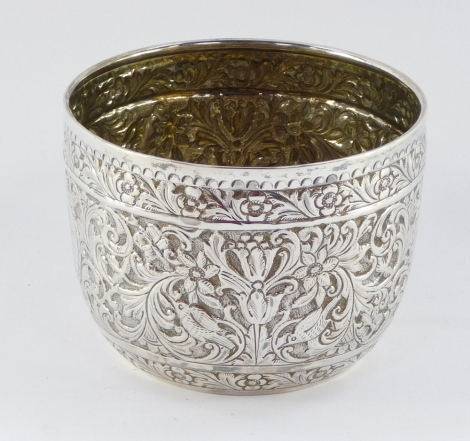 A Victorian silver drinking cup, with hammered floral detailing and central circular crest bearing the initials BMV, with front inscription From Her Uncle and Aunt J & CB, October 1885, makers stamp CSH, London 1884, 8cm high, 6¾oz.