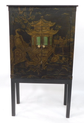 A painted faux Japanned cabinet, with two doors painted with a pagoda, opening to reveal a single shelf, raised on a table base with stile feet, 160cm high, 90.5cm wide, 45cm deep.