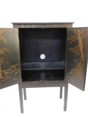 A painted faux Japanned cabinet, with two doors painted with a pagoda, opening to reveal a single shelf, raised on a table base with stile feet, 160cm high, 90.5cm wide, 45cm deep. - 2