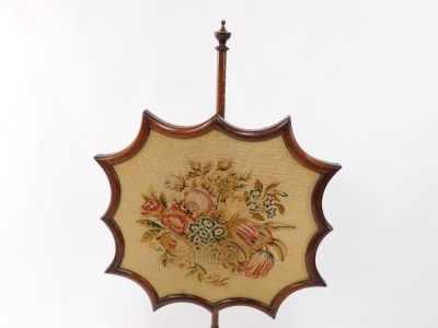 An early Victorian rosewood firescreen, the shaped screen with wool work floral tapestry, raised on a turned column, over a trefoil base, on three turned feet, 149cm high. - 2