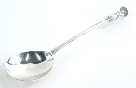 An early 18thC silver apostle spoon, possibly of St Simon the Zealotes, marks indistinct, maker RC, 1¼oz.