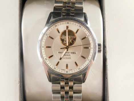 A Raymond Weil gentleman's wristwatch, with silvered dial and open automatic movement, in a stainless steel case, numbered 2710 K410521, dial 3.5cm wide, 177.7g all in, boxed.