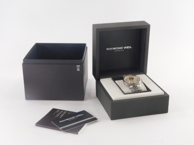 A Raymond Weil gentleman's wristwatch, with silvered dial and open automatic movement, in a stainless steel case, numbered 2710 K410521, dial 3.5cm wide, 177.7g all in, boxed. - 2