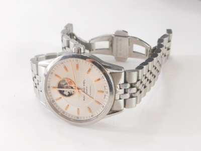 A Raymond Weil gentleman's wristwatch, with silvered dial and open automatic movement, in a stainless steel case, numbered 2710 K410521, dial 3.5cm wide, 177.7g all in, boxed. - 3