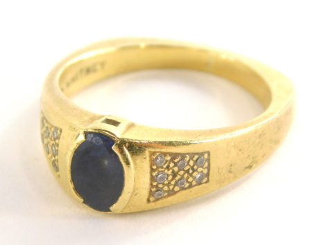 An 18ct gold sapphire and diamond dress ring, the oval sapphire in tension setting, approx 1.31cts, with seven tiny diamond set shoulders, on a square shaped band, ring size V, 10.9g all in.