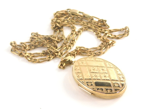 A 9ct gold locket pendant and chain, the oval locket with engraved flower detailing, on a Byzantine link chain, 66cm long, 22.2g all in.