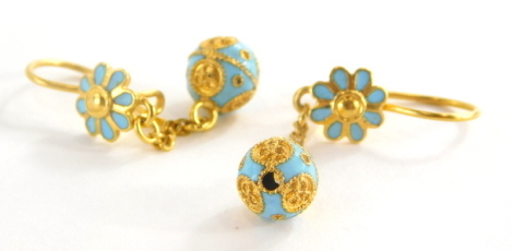A pair of Eastern style enamel drop earrings, each with pale blue enamel flower and ball design, in yellow metal, marked 750, 3.5cm high, 4.2g all in.