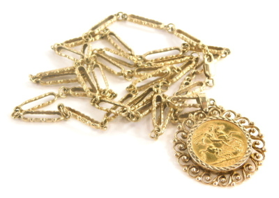 An Elizabeth II full gold sovereign pendant and chain, dated 1966 in scroll detailed 9ct gold pendant frame, on hammered elongated link chain, yellow metal, unmarked, 74cm long, 38g all in.