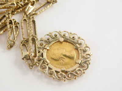 An Elizabeth II full gold sovereign pendant and chain, dated 1966 in scroll detailed 9ct gold pendant frame, on hammered elongated link chain, yellow metal, unmarked, 74cm long, 38g all in. - 2