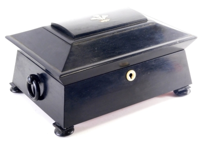A Victorian ebony workbox, the domed lid inlaid with mother of pearl and brass, with a fleur de lys and a coronet, enclosing a fitted interior with embroidered covers, mother and pearl and bone spools, etc., on bun feet, 31cm wide.