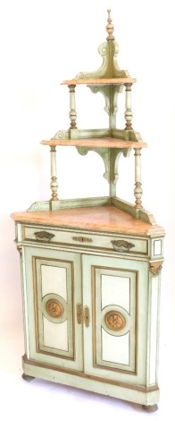 A 19thC Spanish corner whatnot, painted in pale green, cream and gilt, the top with a turned finial above three marble tiers, each with a moulded edge, the base with a frieze drawer above two panelled doors, each with central roundels, on bun feet, 204cm
