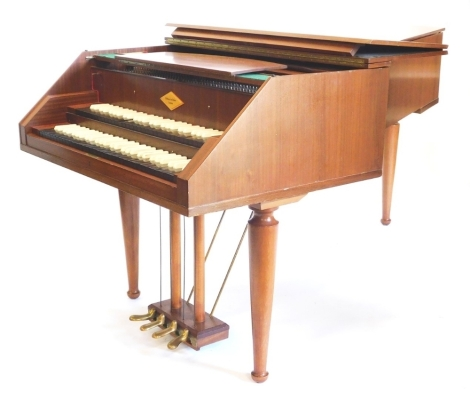 A William de Blaise of London K2 two-manual harpsichord, with two sets of ebony and simulated ivory keys, on turned tapering legs, 104cm wide, 207cm long.