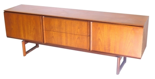 A 1960/70s White and Newton teak low sideboard in the Danish style, with an arrangement of two drawers flanked by two doors on end supports, 69cm high, 199cm wide.