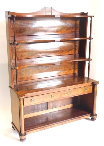 A mid 19thC figured mahogany whatnot cabinet, with a raised back above three shaped shelves, each on cylindrical turned supports, the base with two frieze drawers above a recess, on turned pillars with bun feet, 159cm high, 122cm wide.
