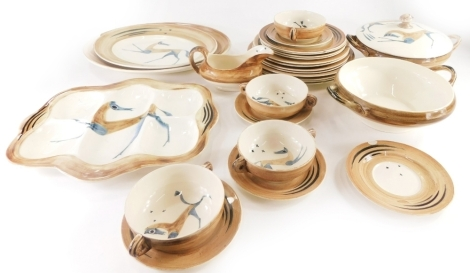 A Clarice Cliff Bizarre Chevaux pattern part dinner service, designed by John Armstrong, decorated with horses in blue and brown within a brown border, to include tureen and cover, hors d'oeuvres dish, two handled soup bowls, various plates, etc., some pi