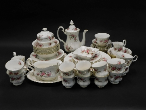 A Royal Albert Lavender Rose pattern part dinner, tea and coffee service, to include coffee pot and cover, dinner plates, sauce boat, etc.