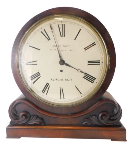 An early Victorian figured mahogany mantel clock, the drum shaped case with painted dial for James Gray, 12 Parliament Square, Edinburgh, the rectangular base embellished with foliate scrolls, fusee movement, 45cm high.